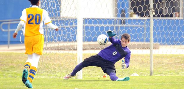 CCLP/LEE LETZER -- Copperas Cove goalie Eric Frazer attempts a save during the Temple tournament.