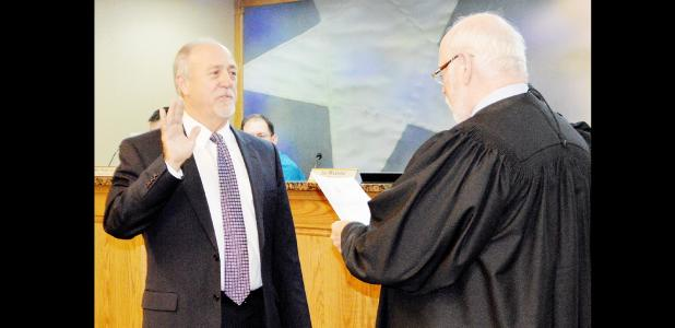 Dan Yancey takes the oath of office for his first full term on Copperas Cove city council place 3 at Tuesday night's city council workshop.