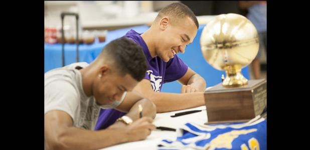 CCLP/DAVID MORRIS - Copperas Cove seniors Devante Robinson, left, and Malyk Thomas participate in a signing ceremony at the high school on Tuesday. Robinson will join former teammate Montre Williams at Division II Northeastern State in Oklahoma. Thomas will play basketball for the NAIA Kansas Wesleyan Coyotes