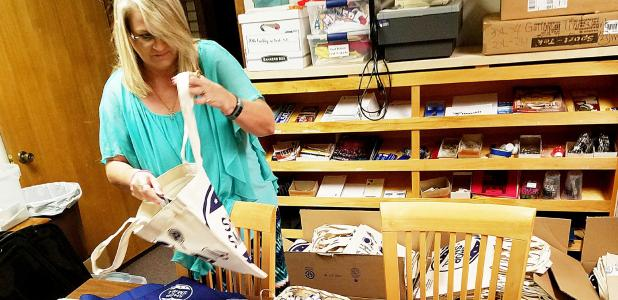 CCLP/DAVID MORRIS - Donna Herring prepares Shop Small Saturday bags for local businesses who are participating in the annual program.