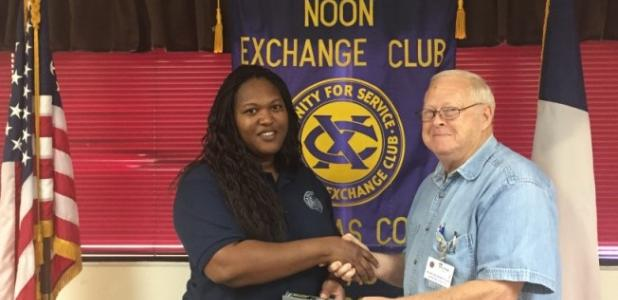 Courtesy Photo Child Abuse Prevention Investigator and Case Worker Torrie White receives an Exchange Club Pen Set from Noon Exchange Club of Copperas Cove President Elect Mike Blount. White served as guest speaker during the Noon Exchange Club of Copperas Cove April 14 Meeting.