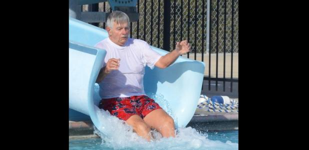 CCLP/LYNETTE SOWELL - Frank Seffrood rides the slide at Saturday's Polar Bear Swim.