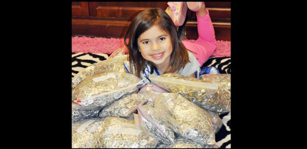 Courtesy Photo - Junior Miss Rabbit Fest Gabriella Ortiz is surrounded by bags of pull tabs from aluminum cans. Gabi donated more than 10,000 tabs weighing more than 25 pounds to the Ronald McDonald House in Temple.