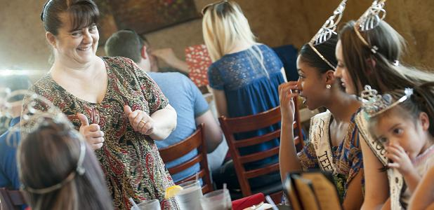 CCLP/DAVID MORRIS Giovanni's Italian Restaurant owner Maura Martinez gives a thumbs up to the royalty as they visit the restaurant for dinner, Wednesday afternoon.  Giovanni's has joined the sponsors list for the inaugural Five Hills Scholarship Pageant with their commitment for the 2016-17 year.