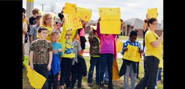 CCLP/DAVID J. HARDIN - House Creek Elementary students hold up signs in support of Connor Hedge during the sendoff rally.