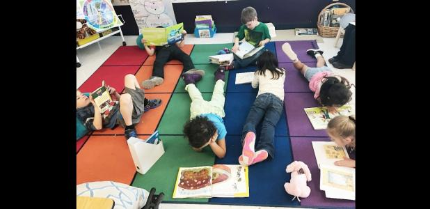 COURTESY PHOTO - House Creek Elementary students enjoy good books as part of World Reading Day as they celebrated Drop Everything and Read for 15 minutes at the end of the school day.