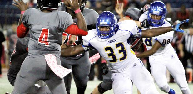Cove defensive lineman Martinez Rogers pressures Heights' quarterback Robert Gray in the first half of action