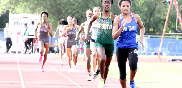 CCLP/TJ MAXWELL ABOVE: Copperas Cove senior Amber Boyd (2:17.76) finishes first in front of Desoto senior Monica Carroll (2:18.41) to earn her first of three Region I-6A berths. Boyd also finished second in the 1,600m run (5:14.05) and fourth in the 4x400m relay (3:58.70) with teammates freshman Anayah Copeland, senior Imari Neal and junior Talia Kinslow. BELOW LEFT: Cove senior Josh Canete competes in the high jump where he set a new personal best mark of 6-feet, 9-inches to win gold. BELOW RIGHT: Cove sen