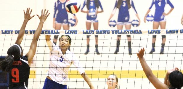 CCLP/TJ MAXWELL -- Copperas Cove senior Raeven Dickerson hits for a kill past Harker Heights senior Kennedi Foster during the Lady Dawgs 3-1 (20-25, 25-7, 25-12, 25-16) win over the Lady Knights Tuesday in Cove. Dickerson shared team-high kill honors with junior Chyanne Chapman and Foster led the match with 11 kills for the Lady Knights.