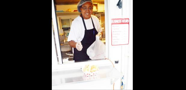 CCLP/LYNETTE SOWELL - Ileana Abascal passes a sandwich through the window of the food truck as she serves customers at their new location in Copperas Cove.