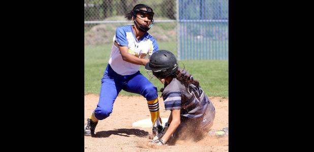 CCLP/TJ MAXWELL - Copperas Cove shortstop Jackie Clay tags out Shoemaker's Celeste Rangel in the third inning of the Lady Dawgs' 10-3 win over the Lady Wolves Wednesday