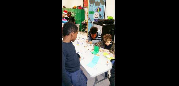 Courtesy Photo/CCISD - Fairview/Miss Jewell Elementary fifth graders Nakeem Freeman, Jayden Jubilee and Daniel Smith work on creating pop-up cards after studying work of illustrator Robert Sabuda. Classes at every grade level celebrated reading campus-wide through 12 different creative stations.