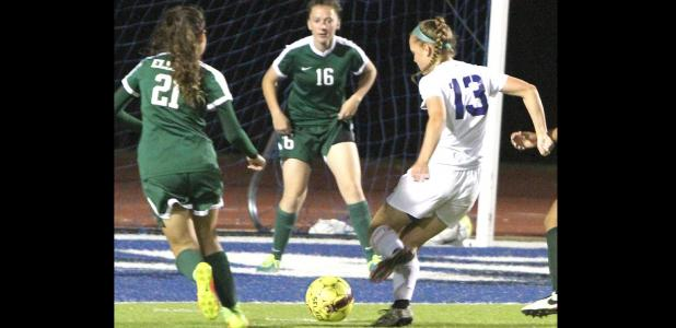 CCLP/TJ MAXWELL - Cove junior Kailey Walker takes a shot on goal in the first half of the Lady Dawgs' 1-0 loss to Ellison. Lady Eagles Britney Guerrero and Kennedi Lewis defend on the play.
