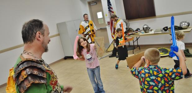 CCLP/FILE - Kids try out their shields during the 2015 Summer Reading program kickoff celebration.