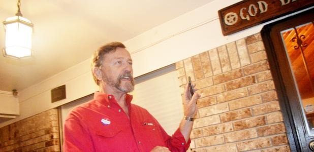 CCLP/LYNETTE SOWELL - Copperas Cove City Council Place 5 incumbent Kirby Lack holds up his phone as he waits for the results to come in Tuesday evening at his home in Copperas Cove. Lack pulled in 58.63 percent of the vote to Marc Payne's 41.37 percent.