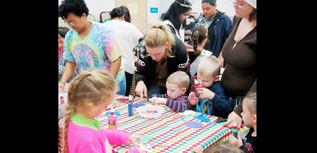 CCLP/BRITTANY FHOLER - Children and their parents made their own ornaments with the help of students from the Copperas Cove High School Art Club at the Copperas Cove Public Library's 3rd annual Family Christmas Party held Wednesday evening.