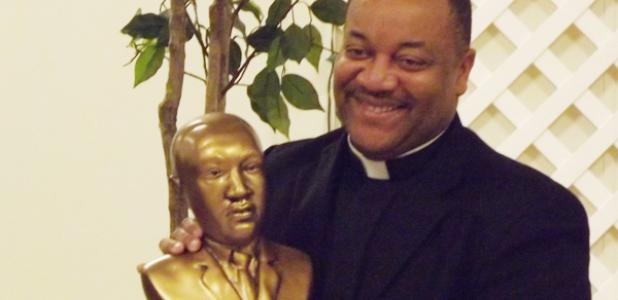 Father Reginald Samuels received a MLK bust as part of the Knights of Columbus MLK dinner event.