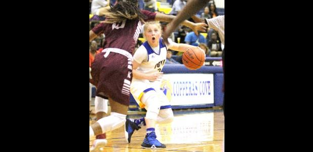 CCLP/TJ MAXWELL - Copperas Cove sophomore Madison Griffon looks for a seam in the Killeen defense during the Lady Dawgs' 49-38 loss in the season finale Tuesday at Bulldawg gymnasium.