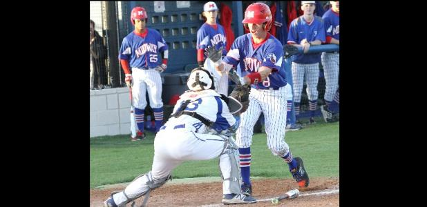 CCLP/TJ MAXWELL - Cove catcher Michael Goudeau tags out Midway's Couper Cornblum in the first inning of their 8-6A clash on Tuesday.