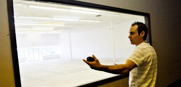 CCLP/LYNETTE SOWELL - Nick Pierce surveys the space that will make up part of the new gym for Fierce Pierce Gymnastics. The gym is moving from Lampasas to Copperas Cove and expects to reopen at their new location within the next two weeks.