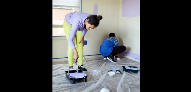 CCLP/LYNETTE SOWELL - Niomi Charmant and Deon Williams paint the walls in what will soon be the store called Thanks For The Little Things, run by their grandmother, Patricia Johnson. The shop on 412 E. Ave. D will offer children's clothing, shoes and more for donations.