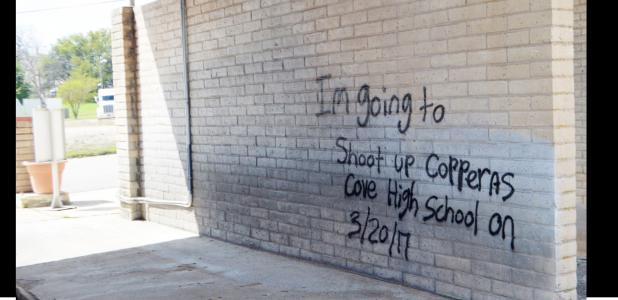 CCLP/LYNETTE SOWELL - Numerous images, one of them a threat to Copperas Cove High School, were spray painted at a vacant car wash on Casa Drive. Copperas Cove High School was on high alert with an increased police presence on Monday.
