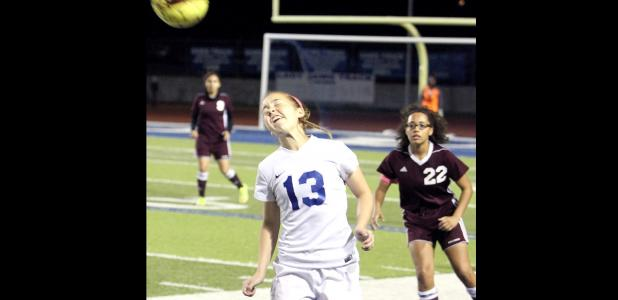 CCLP/TJ MAXWELL - Copperas Cove junior Kailey Walker hits a header in front of Killeen senior Teirra Norman during the Lady Dawgs' 1-0 win.