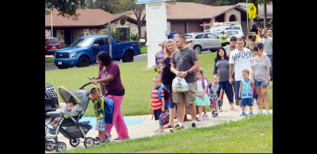 CCLP/LYNETTE SOWELL - Parents and students move in line toward Mae Stevens Early Learning Academy on the first day of the new school year. CCISD had 7,757 students enrolled as of the start of school on Monday, with the freshman class numbering 642 at CCHS, its highest first-day enrollment ever.