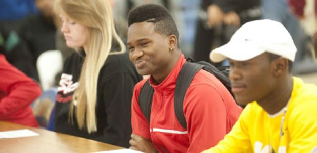 Phillip Baptiste smiles as his accolades are announced during the National Signing Day festivities.