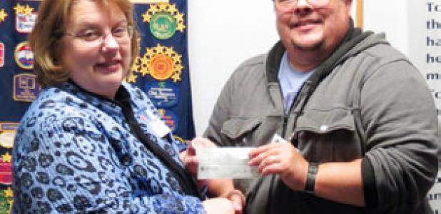 Morning Exchange Club President Mary Derrick presents Joey Ellis of Aware Central Texas with a check for $500 during their Wednesday meeting.