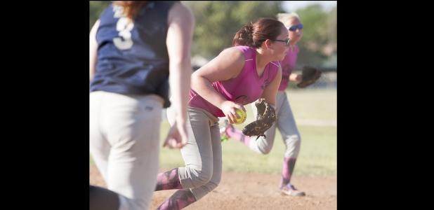 CCLP/DAVID MORRIS - Rachel Morris of the 15-and-under Cove Chaos makes a play on the ball during the 15U District Softball Tournament in McGregor on Wednesday.