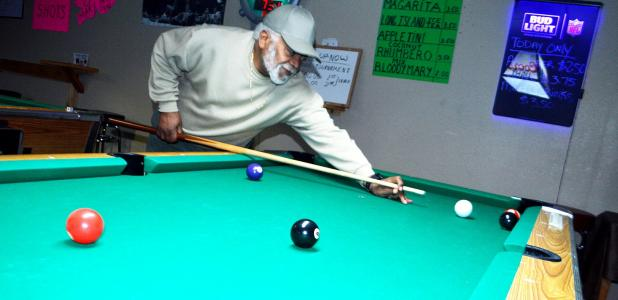 CCLP/LYNETTE SOWELL - Richard Session, owner of Kletus Rack Room, lines up a shot at the pool room he and his wife operate. The pair want to provide a place for families and friends to gather for pool, games, as well as hosting parties.