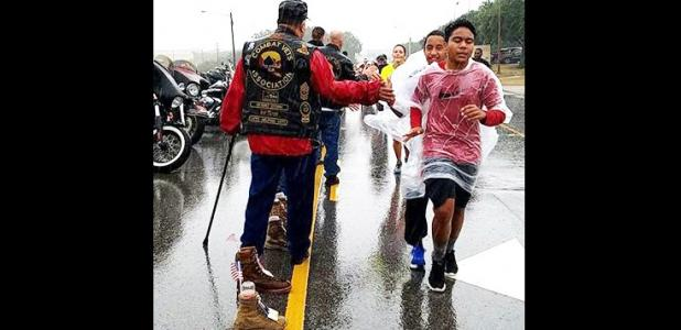 COURTESY PHOTO - Runners, walkers, and some in wheelchairs covered a rain-soaked route Saturday morning on Support Avenue near III Corps Headquarters on Fort Hood. The 3rd annual Remembrance Run, Walk, Roll took place under the direction of Fort Hood Fisher House.