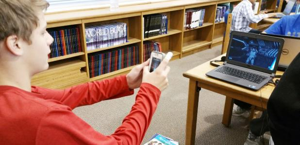 CCISD/Courtesy Photo - S.C. Lee Junior High student Tyler Price uses his phone as a light saber as part of a lesson in computer coding as part of the national Hour of Code event.