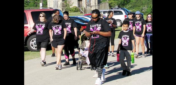 CCLP/PAMELA GRANT - Participants in Team J. Lyons' Walk For Lupus start their 5k run on Saturday at Ogletree Gap Park.