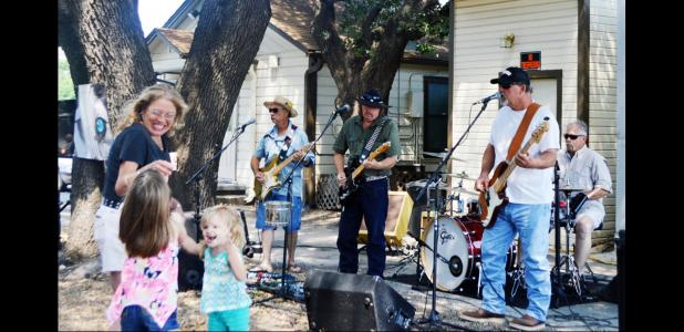 FILE PHOTO - Rare Dog performs under the live oak trees behind Grill Daddy's on Avenue D. The band will be there on Saturday for the restaurant's 2nd annual backyard bash, featuring specials and door prizes.