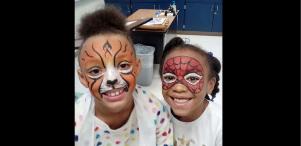 CCISD/COURTESY PHOTO - Clements/Parsons Elementary Malaiyuh Floyd Walters and Assiya Turner show off their freshly painted faces with Walters as a lion and Turner as Spiderman. The two girls each earned 100 Bee Bucks, a school currency for good behavior,