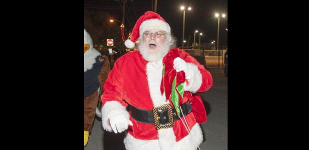 CCLP/LEE LETZER - Santa makes his way to the christmas tree during the tree lighting ceremony, Thursday at Copperas Cove City Park.
