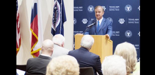 COURTESY PHOTO - Chancellor John Sharp of the Texas A&M University System speaks at the signing of an affiliation agreement between the university and the Executive Director of the Center for Solar Energy.