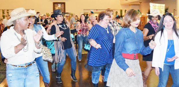 File Photo - The crowd kicks up their heels at last year's Wild West Night held by the Fort Hood Spouses' Club. This year's event is set for March 3 and will help raise funds to benefit local charities and provide student scholarships.