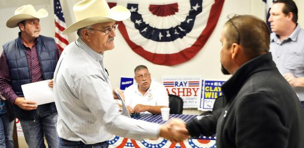CCLP/LYNETTE SOWELL - W.B. Maples and Kyle Matthews shake hands after learning the results of the Tuesday primary election. The two now face each other in a runoff election set for May 24 for Coryell County commissioner precinct 1.