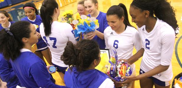 CCLP/TJ MAXWELL Cove seniors are presented with gift baskets from the underclassmen during parents' night and senior night festivities after their sweep of Killeen on Tuesday.
