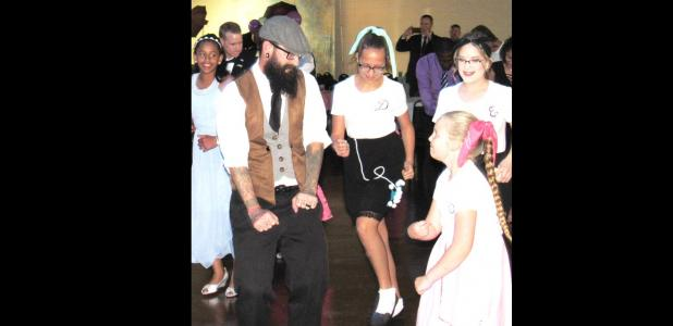 CCLP/BRITTANY FHOLER - Chris Bailey danced with his three daughters Danielle, Erin and Presleigh at the 3rd Annual Daddy Daughter Dance organized by the Parks and Recreation Department and the Youth Advisory Council, held at the Copperas Cove Civic Center Saturday evening.