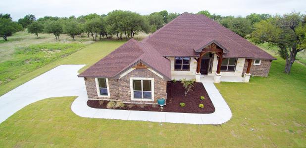 CCLP/GEORGE DUNCAN The four-bedroom, two-bath 2,489 square foot home located at 303 Skyline Dr is a Parade of Homes entry from Summers Homes.  This home has a rock and brick combo with an oversidzed two car garage with side entrance on just over half an acre.