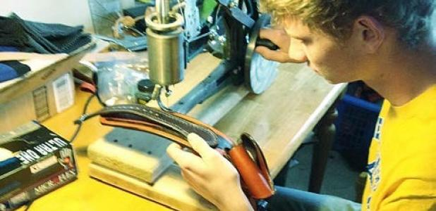 Cove FFA Chapter President Daniel West puts the final touches on his carved leather gun belt to enter in the home economics contest at the Coryell County Youth Fair which run Jan. 15-17.