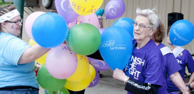 Supporters gather for the release of the Relay for Life survivors' balloon