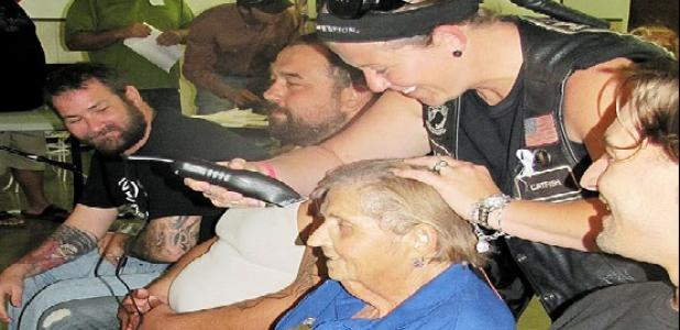 Jerri Jeske has her head shaved after raising $2,000 for the family. Rocky Hughes, Christian Dillon, Daniel Dour, Skip Kelly and Josh Watson each had their heads shaved after reaching the team goal.