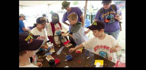 Cub scouts from Pack 252 in Copperas Cove work on building bird houses during arts and crafts Monday during the week long Cub Scout Day Camp on the campus of Central Texas College.