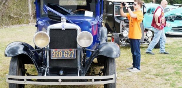 Brennan Kellum grabs a photo of the interior of a 1939 Ford at Saturday's Moose Lodge car show.