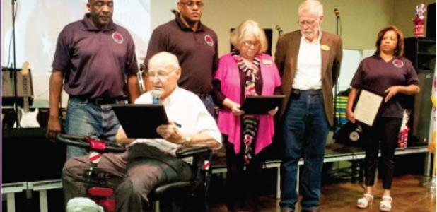 Copperas Cove Mayor John Hull is joined by representatives from Killeen and Harker Heights as he reads the proclamation from the city declaring June 28 as Star Group-Veterans Helping Veterans day.